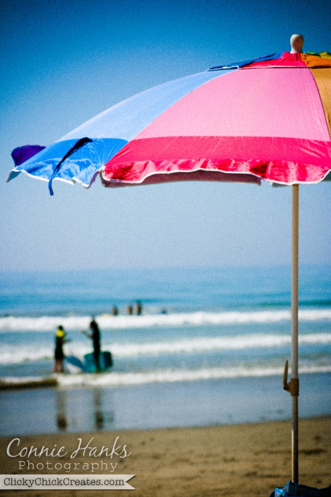 Connie Hanks Photography  //  ClickyChickCreates.com  //  colorful beach umbrella and ocean scene on sunny day