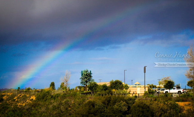 Connie Hanks Photography  //  ClickyChickCreates.com  //  rainbow over canyon and park with grey clouds