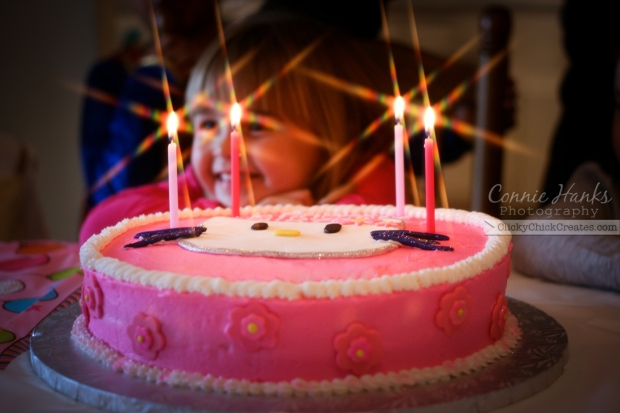 Connie Hanks Photography // ClickyChickCreates.com // pink purple white Hello Kitty birthday cake with 6 cross starburst candle lights