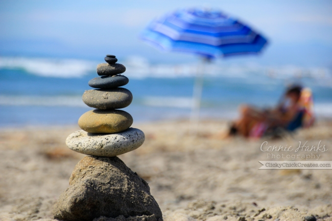 Connie Hanks Photography // ClickyChickCreates.com // Torrey Pines beach, La Jolla, CA, rock art, balance, beach umbrella, relax