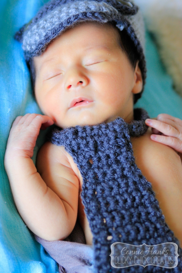 Connie Hanks Photography // ClickyChickCreates.com // newborn session, swaddle, love, young family, bohemian, boho chic, sleeping baby, tie, hat