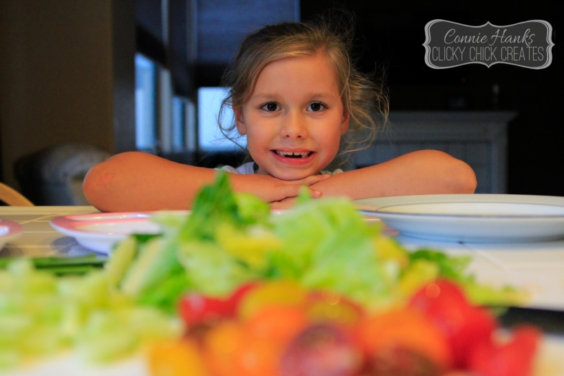 Connie Hanks // ClickyChickCreates.com // what's for dinner, mom? daughter snacking during dinner prep