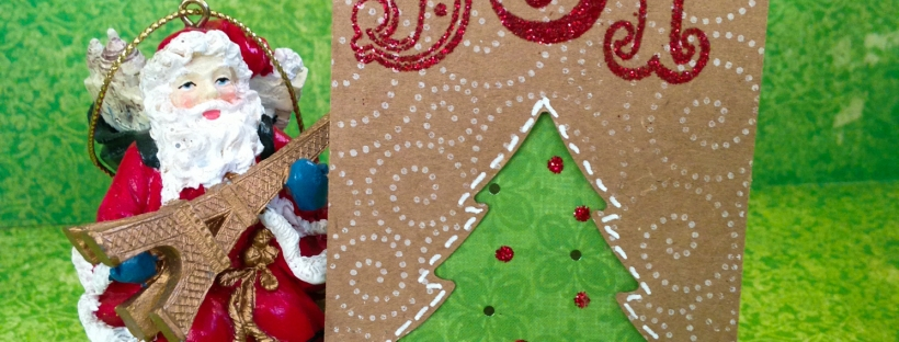 Connie Hanks // ClickyChickCreates.com // Christmas tag on kraft with red tinsel Stampendous Joy, EK Success tree punch, Stickles Christmas Red, Hero Arts Magical Background