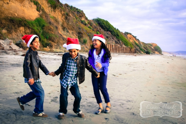 Connie Hanks Photography // ClickyChickCreates.com // Santa hat fun at the beach