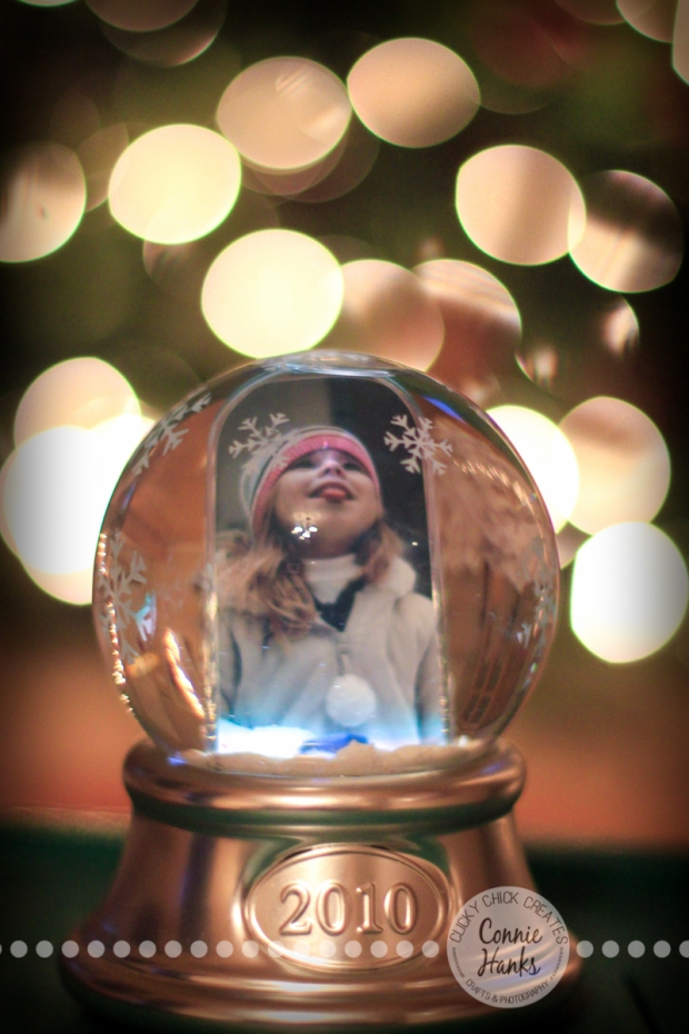 Connie Hanks Photography // ClickyChickCreates.com // Christmas, bokeh, snow globe, tradition, catching snowflakes