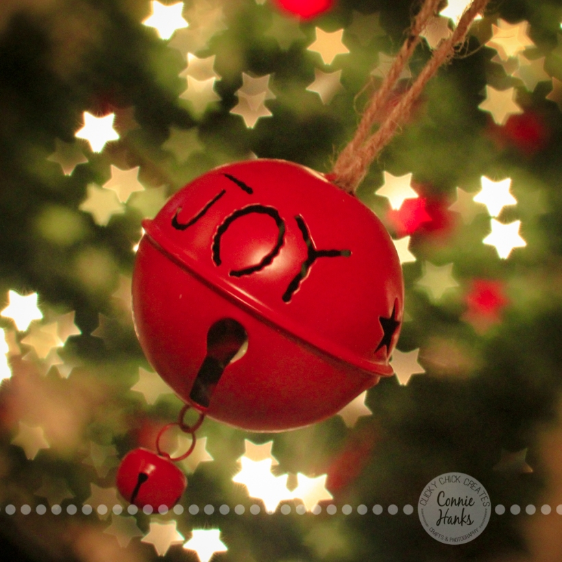 Connie Hanks Photography // ClickyChickCreates.com // Christmas, joy, ornament, star, bokeh, lights, tree, tradition, jingle bell