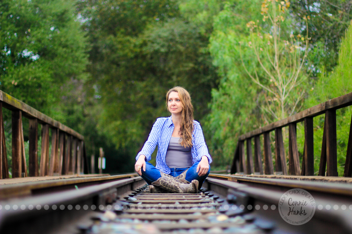 Connie Hanks Photography // ClickyChickCreates.com // rustic, train, tracks, cowboy, cowgirl, boots, lines, perspective