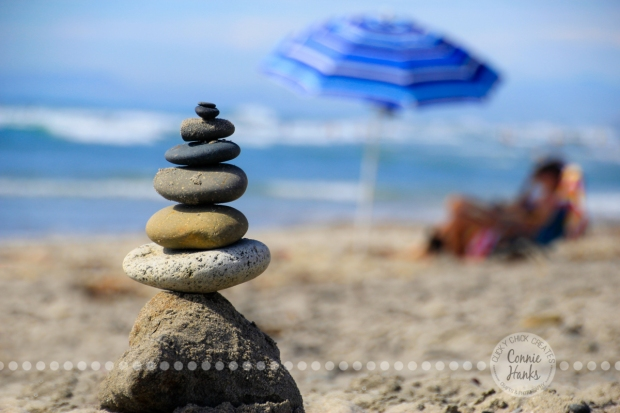 Connie Hanks Photography // ClickyChickCreates.com // San Diego beach, balance, rocks, beach pebbles, umbrella, waves, sand, relaxing
