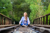 Connie Hanks Photography // ClickyChickCreates.com // sitting outdoors on train track in rustic park!