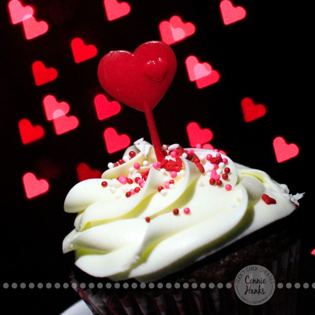Connie Hanks Photography // ClickyChickCreates.com // Valentine's Day cupcake with heart shaped bokeh