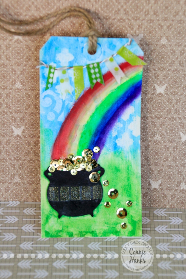 Connie Hanks Photography // ClickyChickCreates.com // St. Patrick's rainbow and pot of gold tag made using Gelatos, Distress Inks, stencils, paint, washi tape, sequins