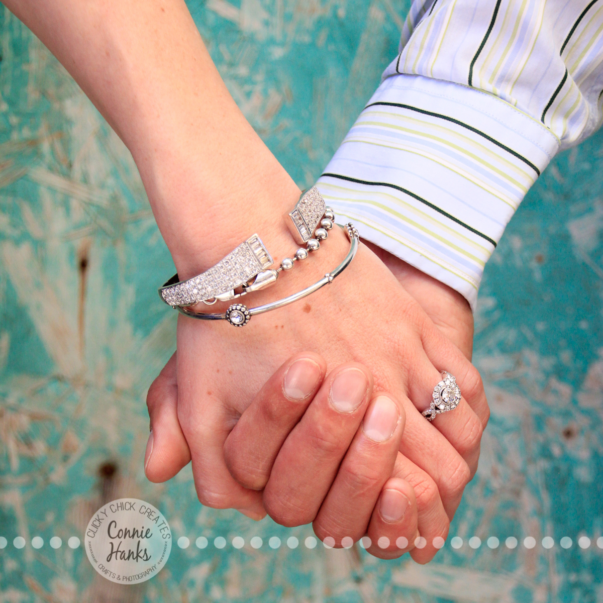 Connie Hanks Photography // ClickyChickCreates.com // engagement couple session, Rosarito, Mexico, mercado, market, colorful, turquoise, blue, gray, wood, wheel, rustic, arches, archways, kiss