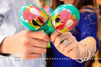 Connie Hanks Photography // ClickyChickCreates.com // engagement couple session, Rosarito, Mexico, mercado, market, maracas, colorful, turquoise, blue, gray, wood, wheel, rustic, arches, archways, kiss
