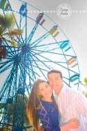 Connie Hanks Photography // ClickyChickCreates.com // engagement couple session, Rosarito, Mexico, mercado, market, colorful, turquoise, blue, gray, wood, wheel, rustic, arches, archways, kiss, ferris wheel, circus