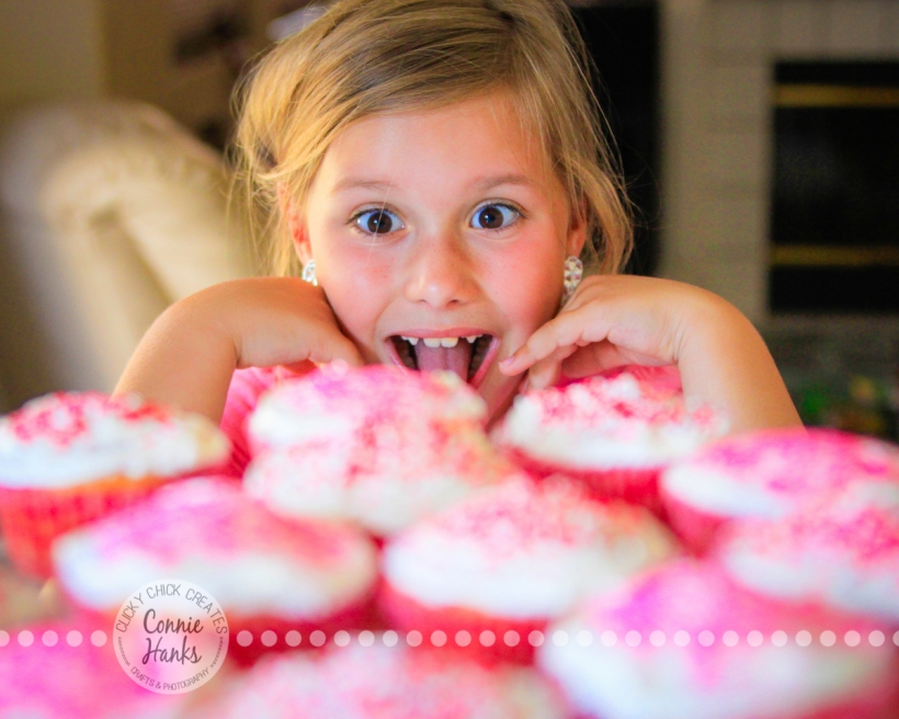 Connie Hanks Photography // ClickyChickCreates.com // Little girl with platter of cupcakes, in awe and ready to devour