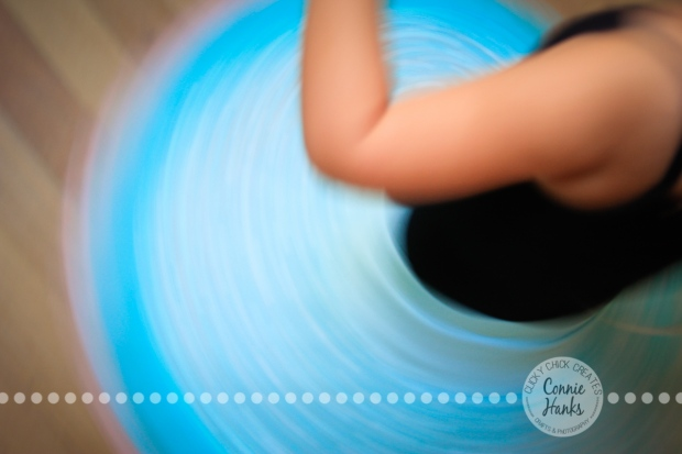 Connie Hanks Photography // ClickyChickCreates.com // Little girl twisting in her twirly skirt