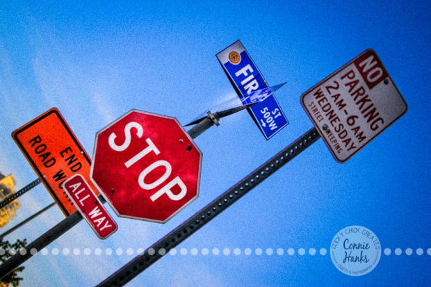 Connie Hanks Photography // ClickyChickCreates.com // street signs, red, stop, blue sky, Little Italy