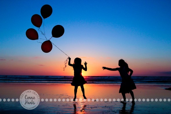 Connie Hanks Photography // ClickyChickCreates.com // Beach Silhouette, sisters, daughters, girls, kids, beach, sunset, jump, balloons, Pacific Ocean, La Jolla Shores