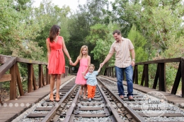 Connie Hanks Photography // ClickyChickCreates.com // Family Photography, Old Poway Park, rustic, park, train, tracks, grass, siblings, coordinated family, salmon, orange, pink, lovely