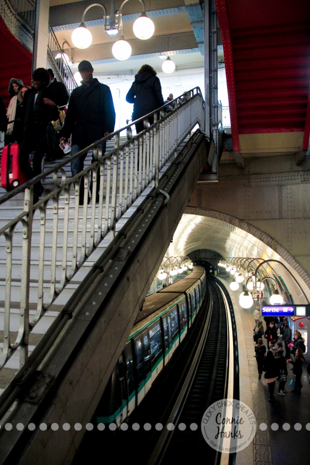 Connie Hanks Photography // ClickyChickCreates.com // Paris Metro, descent, stairs, arches, public, transportation, curve