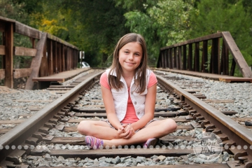 Connie Hanks Photography // ClickyChickCreates.com // Family Photography, mother, daughter, rustic, park, train tracks, train car, coordinated family, oranges, purples, colorful, lovely